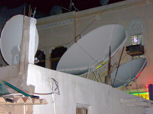 Channel choice: rooftop satellite dishes in the old town of Dubai, UAE